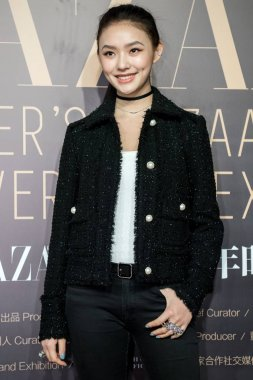 Chinese actress Jelly Lin or Lin Yun poses as she arrives on the red carpet for the opening ceremony of Harper's Bazaar 150th Anniversary Exhibition in Shanghai, China, 21 December 2017.
