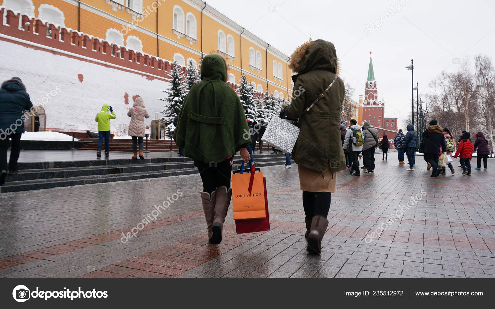 41bfff65d90 Chinese tourists carrying shopping bags of Louis Vuitton (LV) and Furla  visit a scenic spot with others as they travel abroad in Moscow, Russia, 16  January ...
