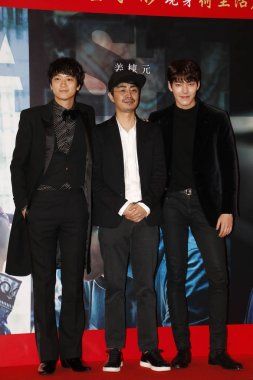 South Korean singer and actor Kim Woo-bin, right, and South Korean actor Gang Dong-won, left, attend a press conference to promote their new movie