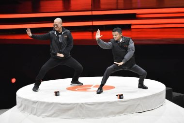 Jack Ma or Ma Yun, chairman of Chinese e-commerce giant Alibaba Group, right, and Chinese martial actor Jet Li, also known as Li Lianjie, perform taiji at the opening game for their movie ''Gong Shou Dao'' (the art of attack and defence) in Beijing,