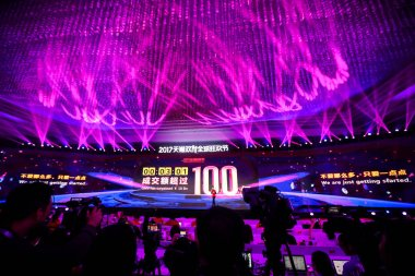 A giant electronic screen shows the total GMV (Gross Merchandise Volume) from online shopping on Chinese e-commerce giant Alibaba's marketplaces Tmall and Taobao exceeding RMB10 billion (US$1.5 billion) in the first three minutes of the Tmall 11.11 G