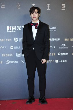 Hong Kong singer and dancer Jackson Wang of South Korean boy group GOT7 poses as he arrives on the red carpet for the 14th Annual Esquire MAHB 'Man At His Best' awards ceremony in Beijing, China, 22 November 2017.