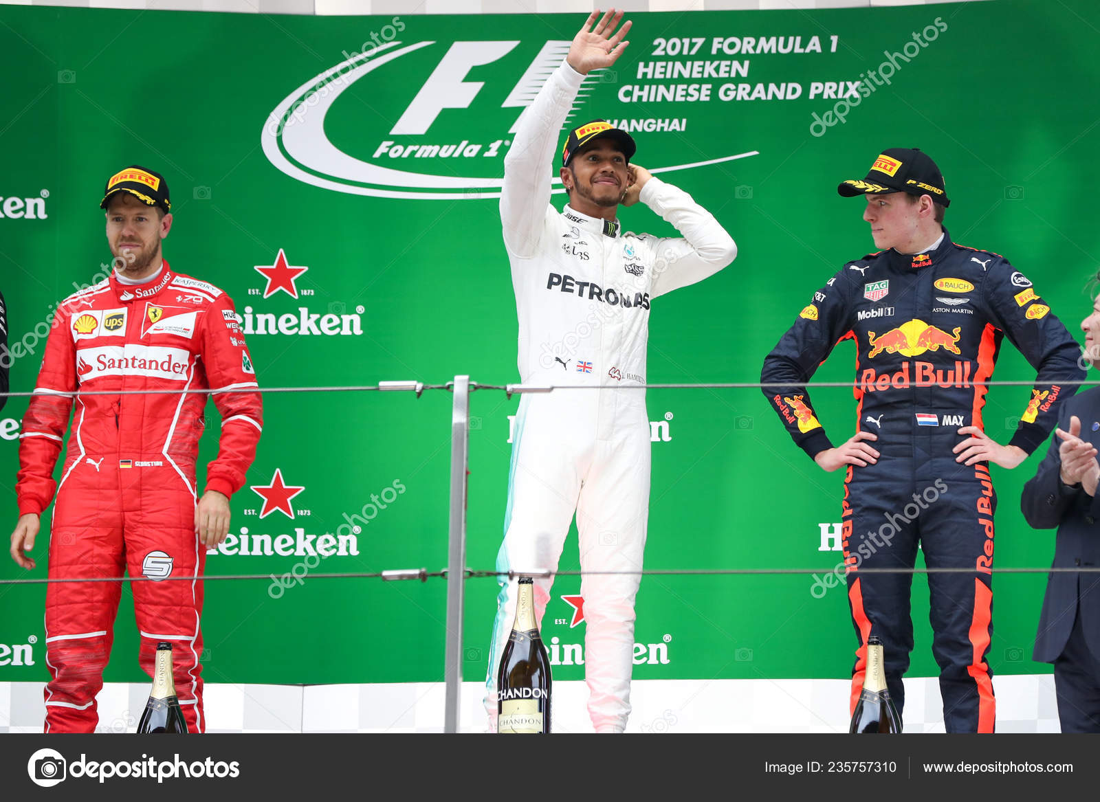 42376f95 British F1 driver Lewis Hamilton of Mercedes AMG, center, waves between German  F1 Sebastian Vettel of Ferrari, left, and Dutch F1 driver Max Verstappen of  ...