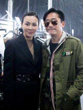 Hong Kong actress Carina Lau, left, and her actor husband Tony leung chiu wai, attend the fashion show of Lau's own brand Anirac during the Shanghai Fashion Week Fall/Winter 2017 in Shanghai, China, 10 April 2017.