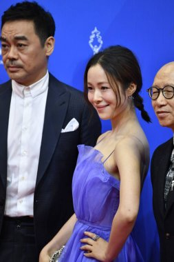 Chinese actress Jiang Yiyan, right, and Hong Kong actor Sean Andy arrive on the red carpet for the opening ceremony of the 7th Beijing International Film Festival in Beijing, China, 16 April 2017.