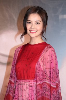 Singers and actresses Gillian Chung, left, and Charlene Choi of Hong Kong pop duo Twins attend a premiere for their movie
