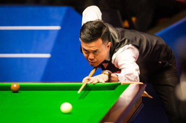 Marco Fu of Hong Kong plays a shot to Jimmy Robertson of England in the first phase of their second round match during the 2017 Betfred World Snooker Championship at the Crucible Theatre in Sheffield, UK, 24 April 2017