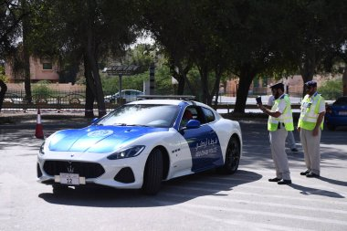 A police car of Maserati patrols ahead of the AFC Asian Cup group C match between China and Kyrgyzstan near the Sheikh Khalifa International Stadium in Abu Dhabi, United Arab Emirates, 7 January 2019.