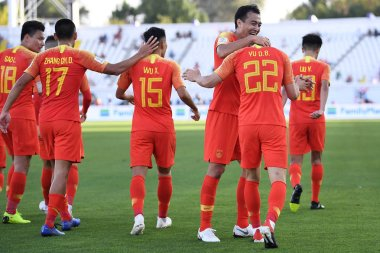 Players of China national football team celebrate after scoring against Kyrgyzstan national football team in their AFC Asian Cup group C match at the Sheikh Khalifa International Stadium in Abu Dhabi, United Arab Emirates, 7 January 2019