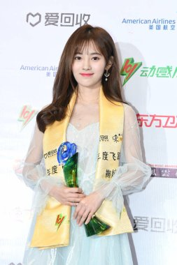 Ju Jingyi of Chinese girl group SNH48 poses with her trophy during the 24th Chinese Top Ten Music Awards in Shanghai, China, 27 March 2017.