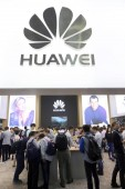 Visitors try out electronic products of Huawei during the 2016 International Consumer Electronics Show Asia (CES Asia) in Shanghai, China, 11 May 2016