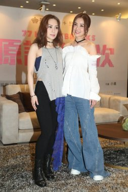 Hong Kong singers and actresses Gillian Chung, left, and Charlene Choi of Hong Kong pop duo Twins attend a press conference to promote their new movie