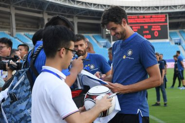 Italian professional football player Andrea Ranocchia of Inter Milan poses signs autographs for fans during a training session for the 2017 Changzhou Dragon City Cup International Football Invitation Tournament against Inter Milan in Changzhou city,