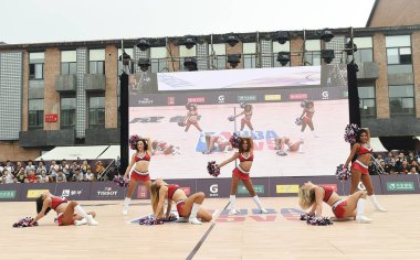 A cheering squad performs during the opening ceremony of