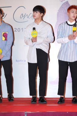 Im Hyun-sik, left, and Jung Il-hoon of South Korean boy group BTOB attend a press conference for