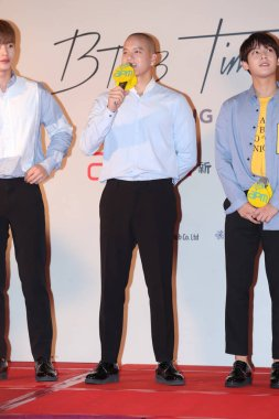 Peniel Shin, left, and Lee Min-hyuk of South Korean boy group BTOB attend a press conference for