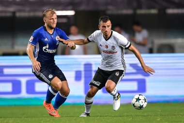 German football player Johannes Geis of FC Schalke 04, left, challenges a player of Besiktas J.K. in a friendly soccer match in Zhuhai city, south China's Guangdong province, 19 July 2017
