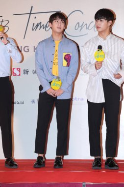 Lee Min-hyuk, left, and Im Hyun-sik of South Korean boy group BTOB attend a press conference for