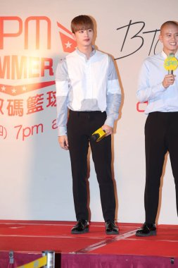 Yook Sung-jae, left, and Peniel Shin of South Korean boy group BTOB attend a press conference for
