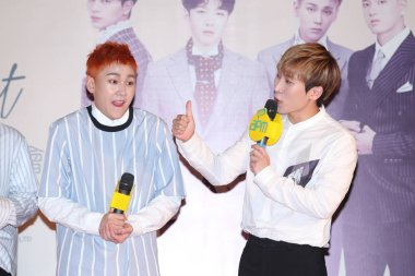 Jung Il-hoon, left, and Seo Eunkwang of South Korean boy group BTOB attend a press conference for