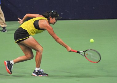 Peng Shuai of China returns a shot to Tereza Martincova of Czech Republic in their women's singles second round match of the WTA 2017 Jiangxi Open tennis tournament in Nanchang city, east China's Jiangxi province, 27 July 2017