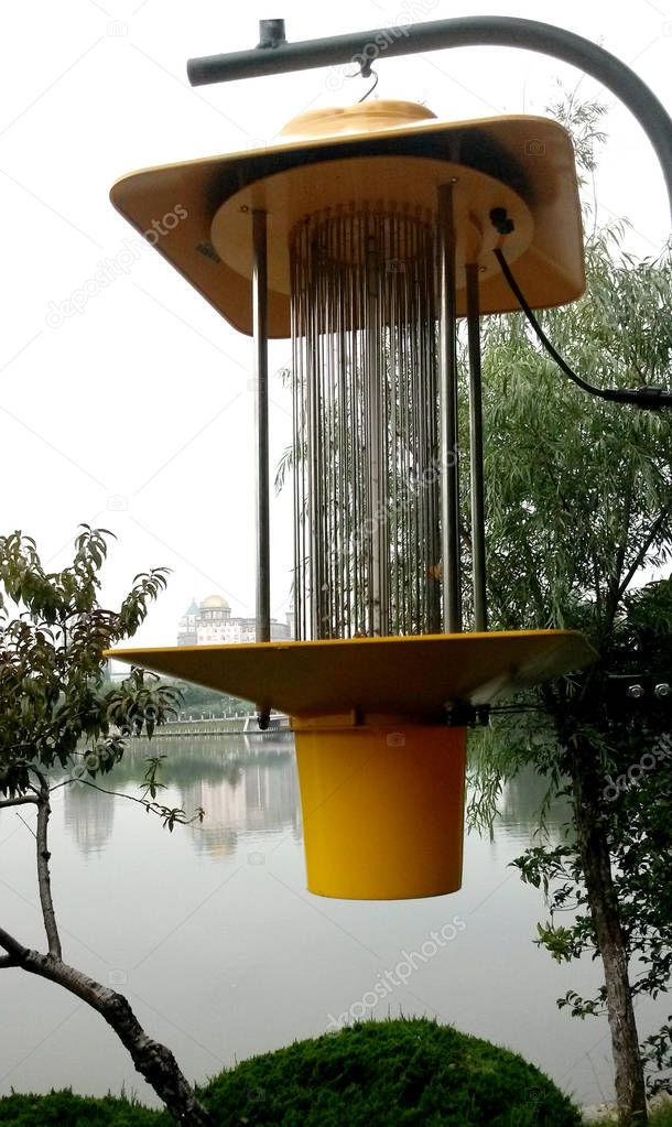 A solar energy mosquito killing lantern is pictured at Haodong Ecological Park in Nantong city, east China's Jingsu pqrovince, 4 July 2017