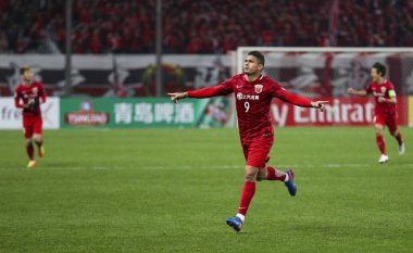 Elkeson of China's Shanghai SIPG celebrates after scoring a goal against Japan's Urawa Red Diamonds in their Group F match during the AFC Champions League 2017 in Shanghai, China, 15 March 2017.