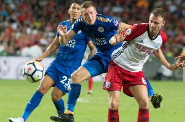 Jamie Vardy of Leicester City F.C., center, challenges Jonny Evans of West Bromwich Albion F.C. in the semifinal match during the 2017 Premier League Asia Trophy soccer tournament in Hong Kong, China, 19 July 2017
