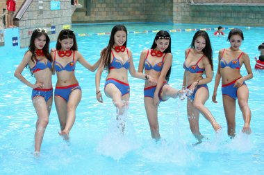 Bikini-dressed young women take part in a promotional campaign for recruitment of tourist experience reporters at 37 Degree Dream Sea Park in Yantai city, east China's Shandong province, 19 July 2017.