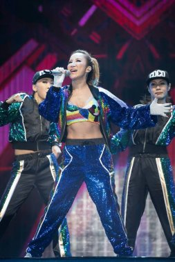 Hong Kong-born American singer-songwriter Coco Lee performs during the Asian Music Gala 2017 in Guangzhou city, south China's Guangdong province, 19 July 2017.