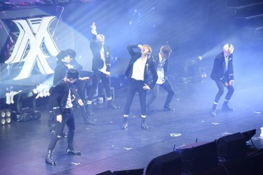 Members of South Korean boy group Monsta X perform during The First World Tour