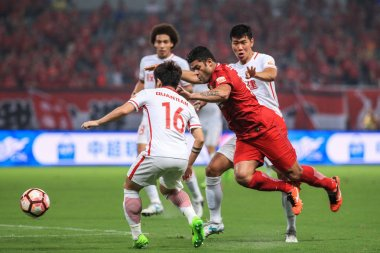Brazilian football player Givanildo Vieira de Sousa, better known as Hulk, right, of Shanghai SIPG, challenges players of Tianjin Quanjian in their 20th round match during the 2017 Chinese Football Association Super League (CSL) in Shanghai, China, 6