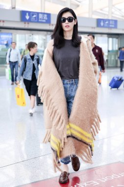 Chinese model Xi Mengyao, better known as Ming Xi, is pictured at the Beijing Capital International Airport in Beijing, China, 30 September 2017.