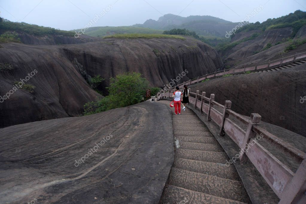 Tourists visit the micro-Danxia landform landscape featuring fingers with apparent joints and clear-cut fingerprints, called as ''God's fingers'', in Feitian Mountain Tourist Resort in Binzhou city, central China's Hunan province, 7 September 2017