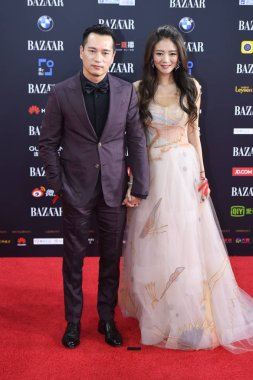 Taiwanese actress and singer Ady An Yi-xuan, right, and her husband Levo Chen pose as they arrive on the red carpet for the 2017 Bazaar Star Charity Night Gala in Beijing, China, 9 September 2017.