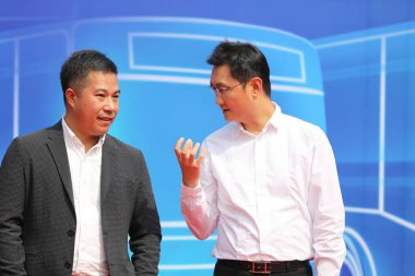 Pony Ma Huateng, right, Chairman and CEO of Tencent Holdings Ltd., attends the launch event for the riding QR codes of bus fare payment though WeChat Pay of messaging app Weixin, or WeChat, of Tencent, in Hefei city, east China's Anhui province, 13 S