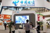 People visit the stand of China Telecom during an exhibition in Nanjing city, east Chinas Jiangsu province, 13 September 2014