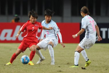 Riko Ushijima, right, of Japan challenges Sung Hyang Sim of DPR of Korea in their final match during the AFC U-19 Women's Championship China 2017 in Nanjing city, east China's Jiangsu province, 28 October 2017