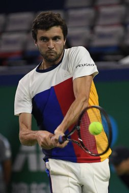Gilles Simon of France returns a shot to Aljaz Bedene of England in their second round match of the men's singles during the 2017 Shanghai Rolex Masters at Qizhong Stadium in Shanghai, China, 11 October 2017