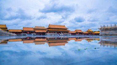 Landscape of the Palace Museum, also known as the Forbidden City, with reflection in puddles after rain in Beijing, China, 12 October 2017