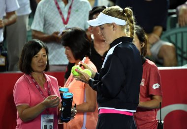 Danish tennis player Caroline Wozniacki signs her autographs on tennis balls for spectators after she announced her withdrawal from Prodential Hong Kong Tennis Open 2017 due to injury during a training session in Hong Kong, China, 12 October 2017