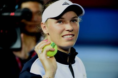 Danish tennis player Caroline Wozniacki throws tennis balls with her autographs to spectators after she announced her withdrawal from Prodential Hong Kong Tennis Open 2017 due to injury during a training session in Hong Kong, China, 12 October 2017
