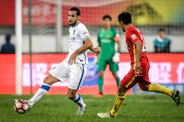 Spanish football player Mario Suarez, left, of Guizhou Hengfeng Zhicheng, challenges a player of Changchun Yatai in the 27th round match during the 2017 Chinese Football Association Super League (CSL) in Guiyang, southwest China's Guizhou province, 1