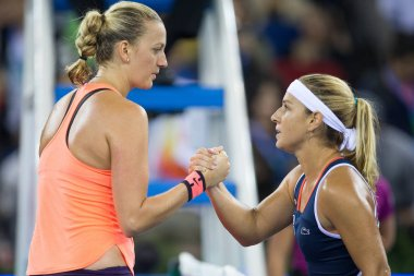 Petra Kvitova of Czech Republic, left, greets Dominika Cibulkova of Slovakia after defeating her in their women's singles fnal match during the WTA Wuhan Open 2016 tennis tournament in Wuhan city, central China's Hubei province, 1 October 2016