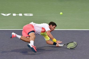 Mischa Zverev of Germany returns a shot to Zhang Ze of China in their first match of the men's singles during the 2016 Shanghai Rolex Masters tennis tournament in Shanghai, China, 10 October 2016