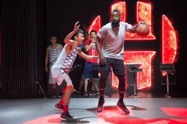 NBA star James Harden, right, plays basketball during a promotional campaign for Adidas in Beijing, China, 7 September 2016.