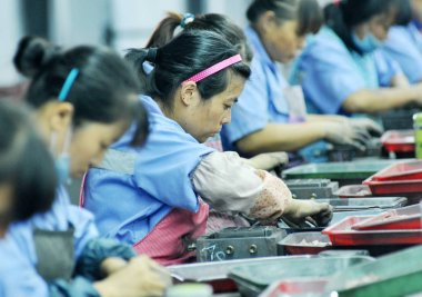 Female Chinese workers manufacture diamond cutter heads at a factory in Zhuhu village, Poyang county, Shangrao city, east China's Jiangxi province, 10 September 2016