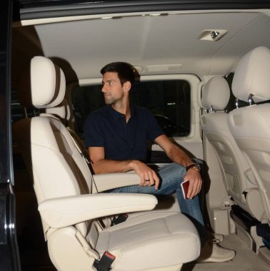 Novak Djokovic of Serbia is pictured in a car after arriving at the Shanghai Pudong International Airport for the 2016 Shanghai Rolex Masters tennis tournament in Shanghai, China, 8 October 2016.