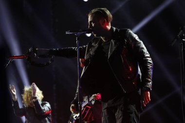American pop rock band OneRepublic performs during a gala for the Tmall 11.11 Global Shopping Festival 2016 in Shenzhen city, south China's Guangdong province, 10 November 2016.
