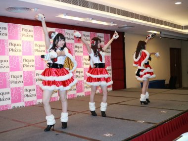 (From left) Saya Kawamoto, Tomu Mutou and Haruka Komiyama of Japanese girl group AKB48 perform at a fan meeting in Hong Kong, China, 19 December 2016.